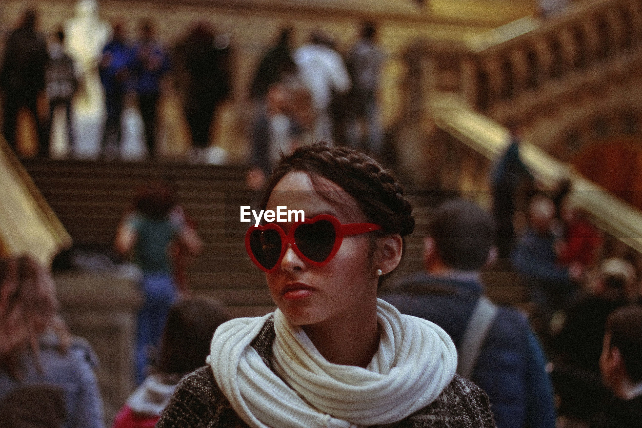 Teenage girl wearing novelty glasses in city