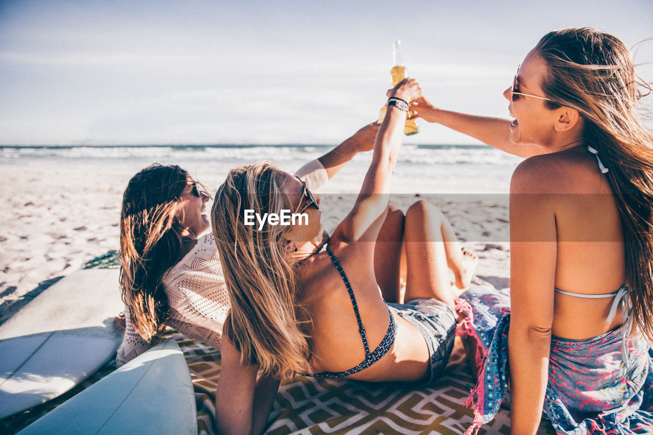 water, sea, women, real people, togetherness, leisure activity, emotion, friendship, young women, beach, drink, lifestyles, group of people, young adult, happiness, holiday, travel, bonding, positive emotion, drinking, outdoors