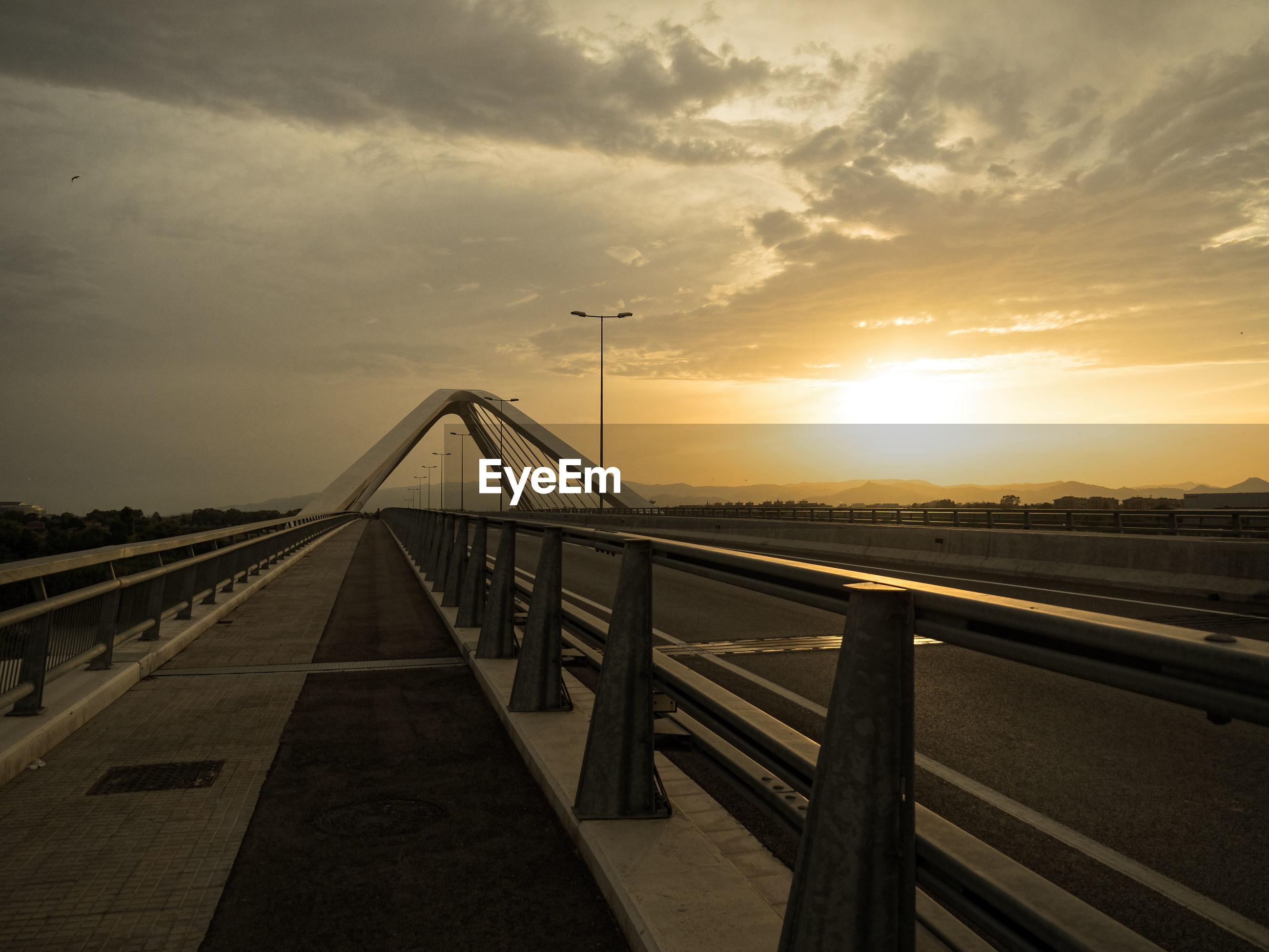 VIEW OF SUSPENSION BRIDGE AGAINST SKY