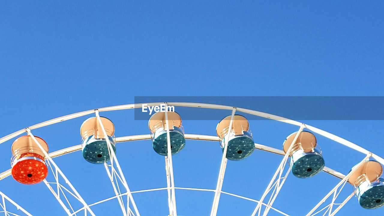 Cropped Image Of Ferris Wheel Against Clear Blue Sky
