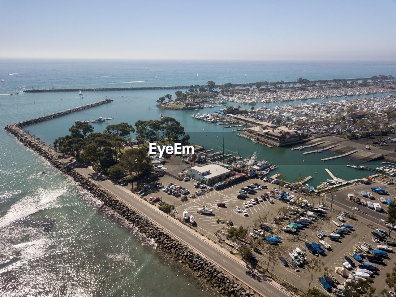 water, high angle view, sea, sky, horizon, horizon over water, nature, aerial view, transportation, architecture, built structure, day, building exterior, scenics - nature, nautical vessel, clear sky, mode of transportation, outdoors, no people, swimming pool
