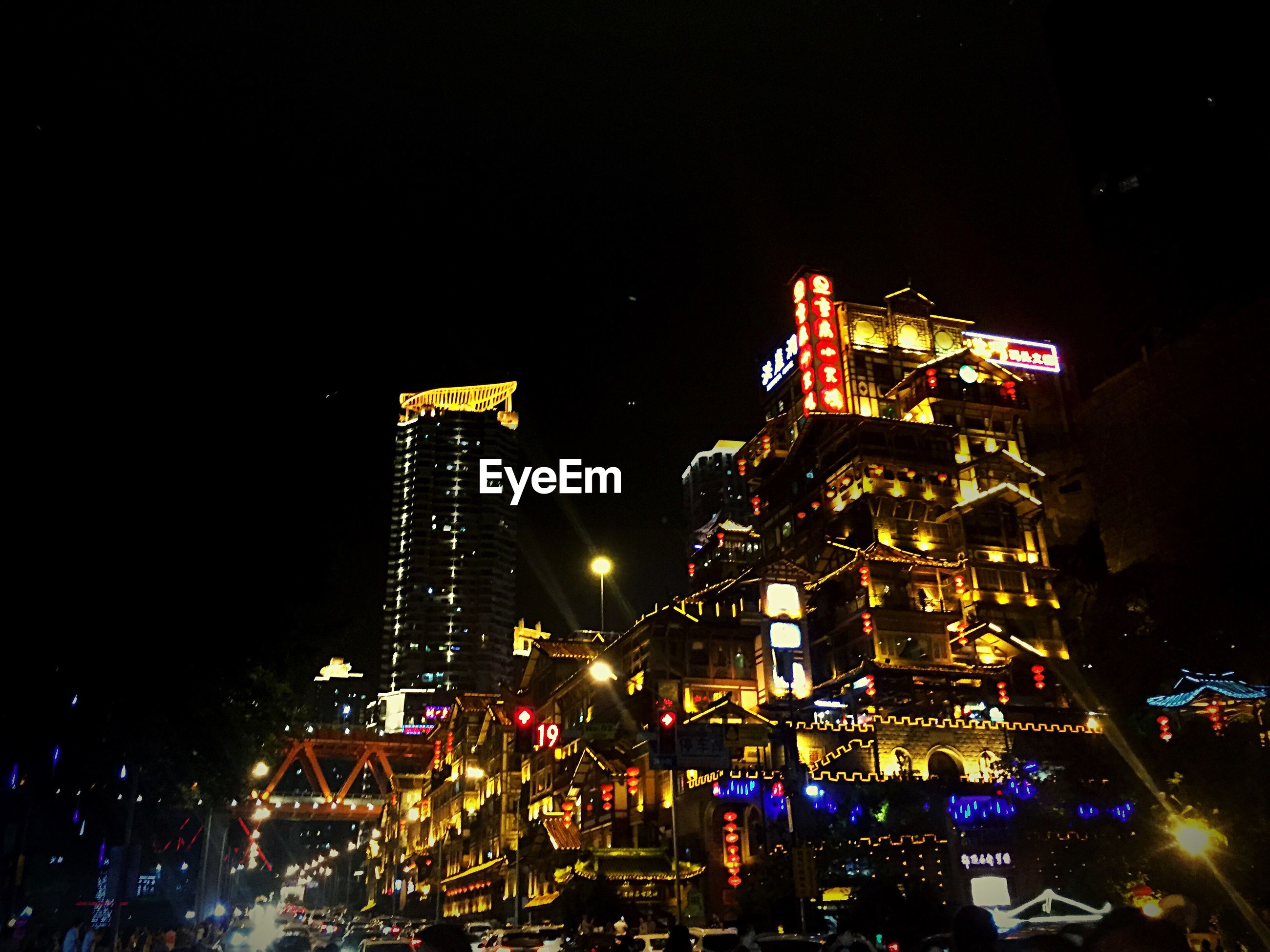 illuminated, night, building exterior, city, built structure, architecture, lighting equipment, sky, copy space, clear sky, light - natural phenomenon, cityscape, development, outdoors, arts culture and entertainment, tall - high, city life, glowing, no people, amusement park