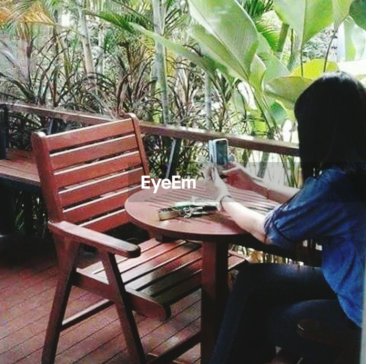 one person, sitting, table, chair, real people, day, plant, women, one woman only, only women, outdoors, tree, one young woman only, adult, people, adults only