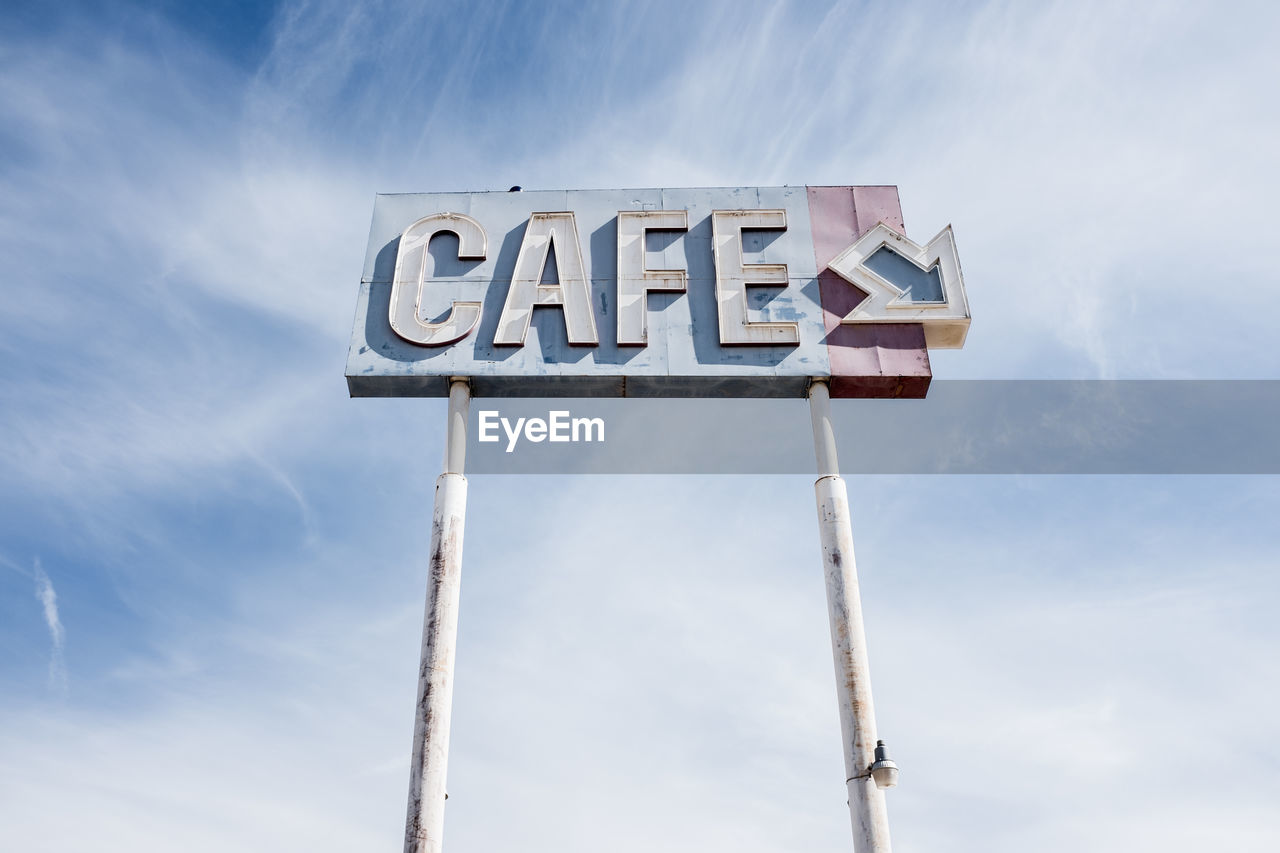 Low Angle View Of Cafe Sign Against Sky