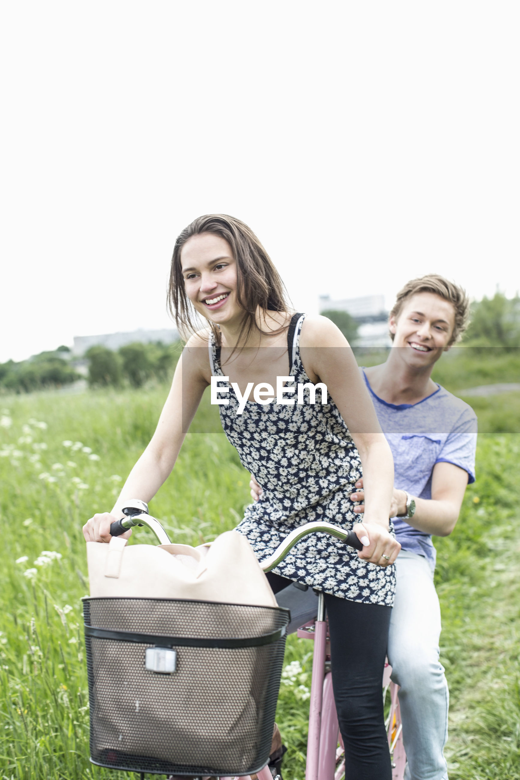 WOMAN SMILING ON FIELD