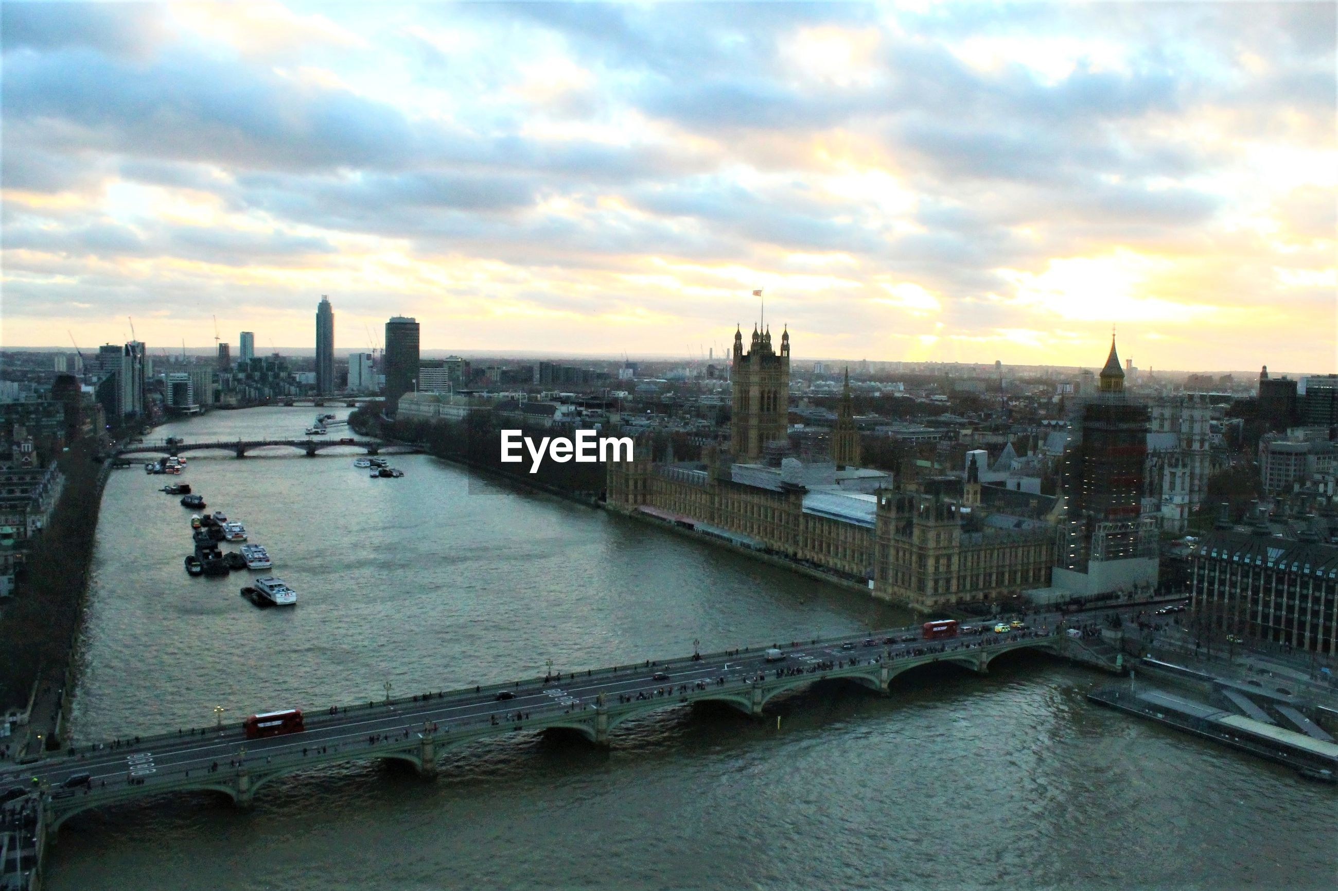 High angle view of westminster bridge over river against buildings in city