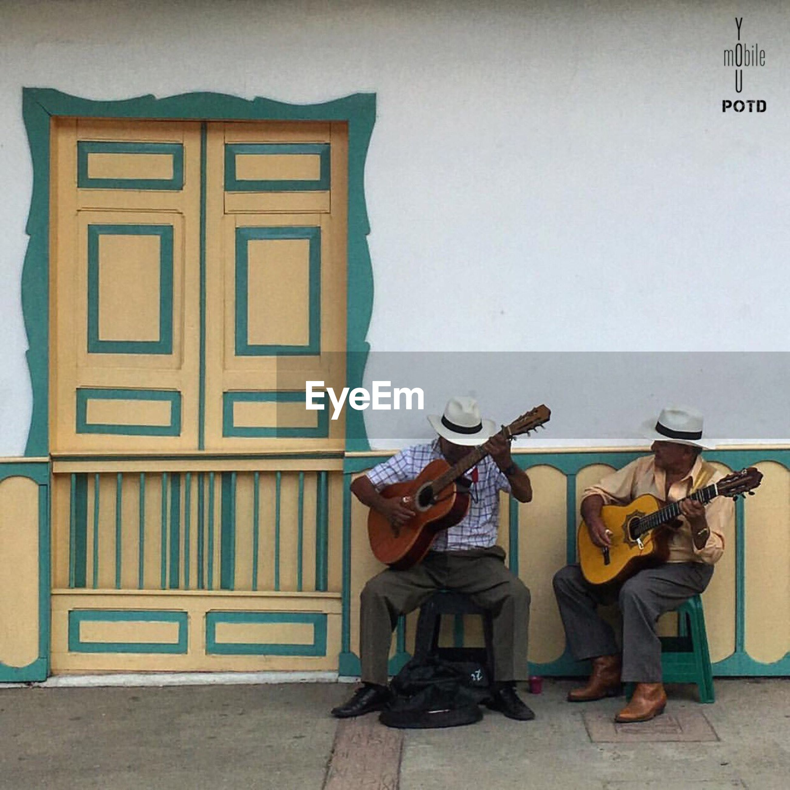 real people, two people, architecture, built structure, playing, full length, standing, day, building exterior, lifestyles, men, musical instrument, musician, outdoors, people