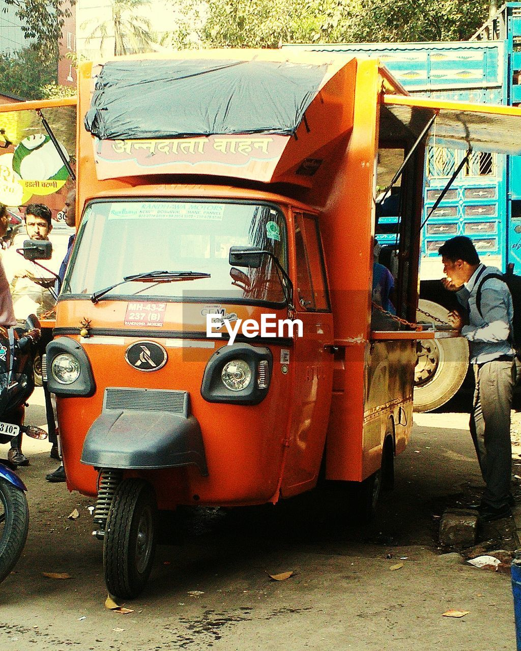 transportation, real people, mode of transport, land vehicle, men, day, sitting, full length, outdoors, built structure, one person, architecture
