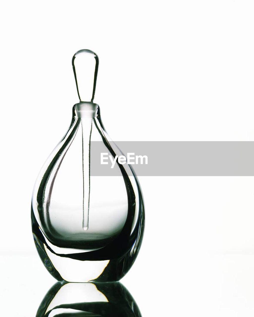 LOW ANGLE VIEW OF LAMP OVER WHITE BACKGROUND