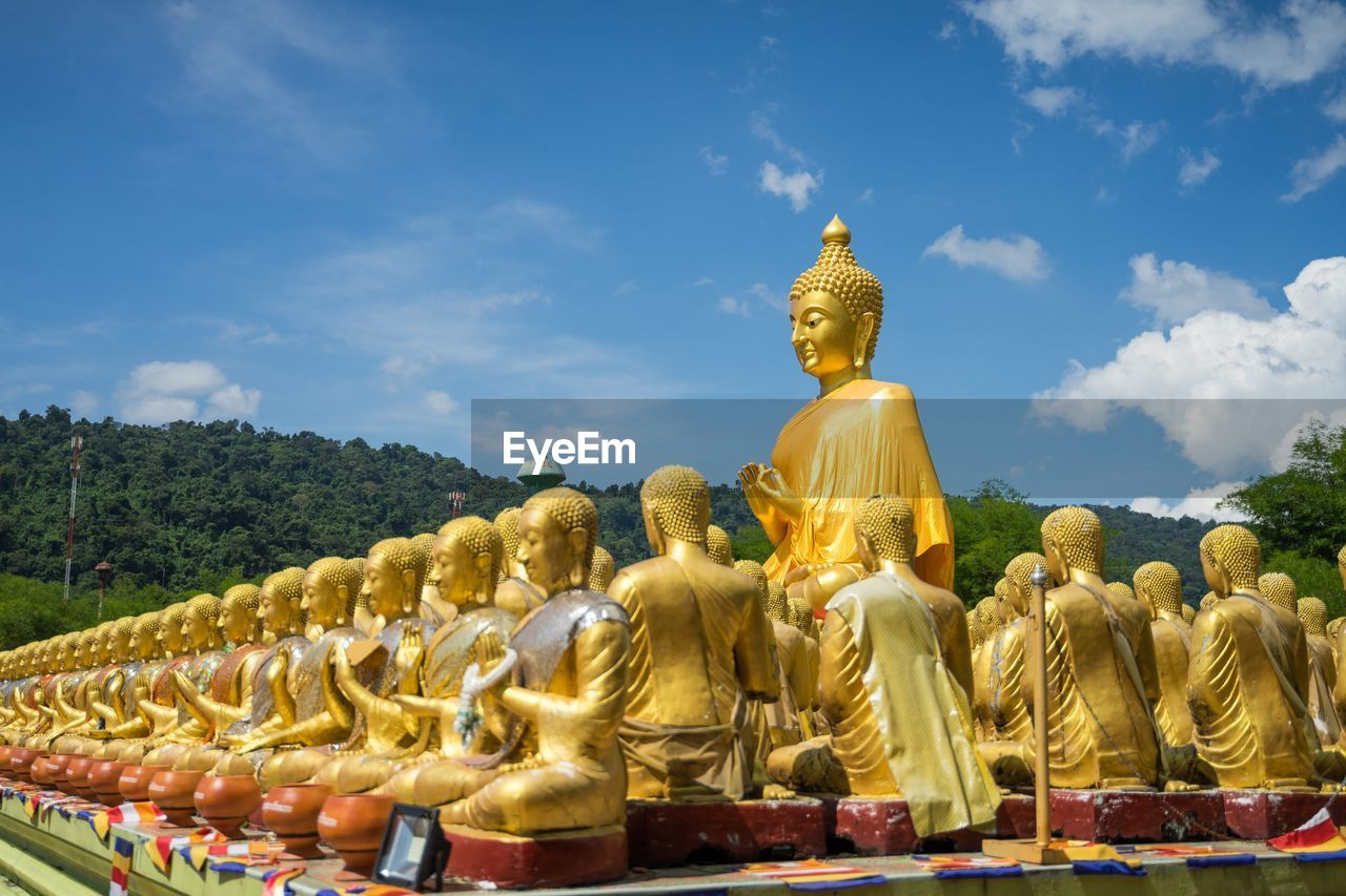 sculpture, statue, representation, religion, human representation, art and craft, belief, male likeness, spirituality, sky, creativity, gold colored, nature, place of worship, cloud - sky, built structure, day, idol, no people