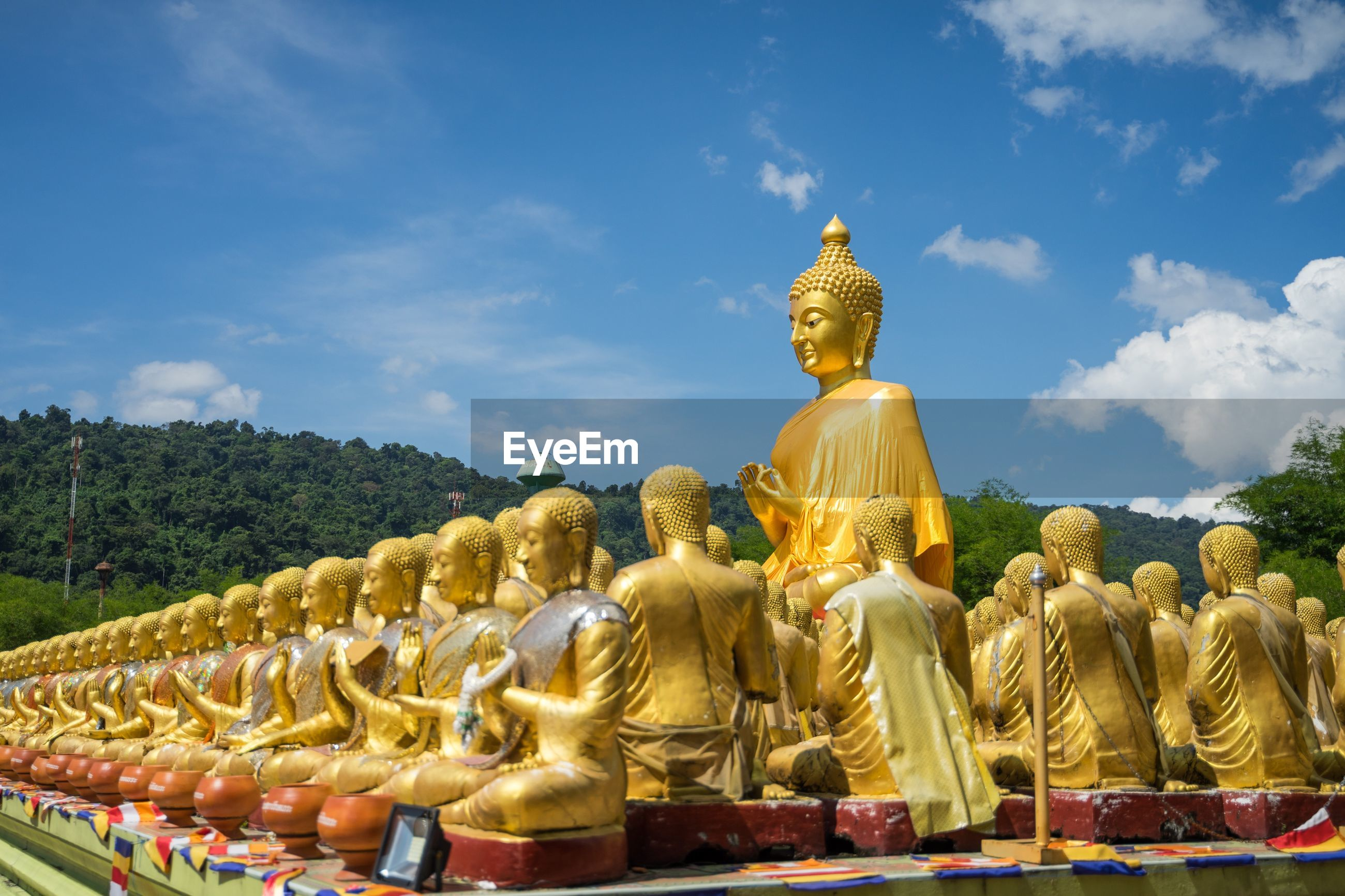 Bhudda statue against temple against sky