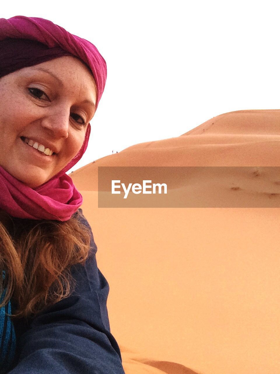 sand, one person, real people, sand dune, desert, nature, outdoors, smiling, day, sky, close-up, people