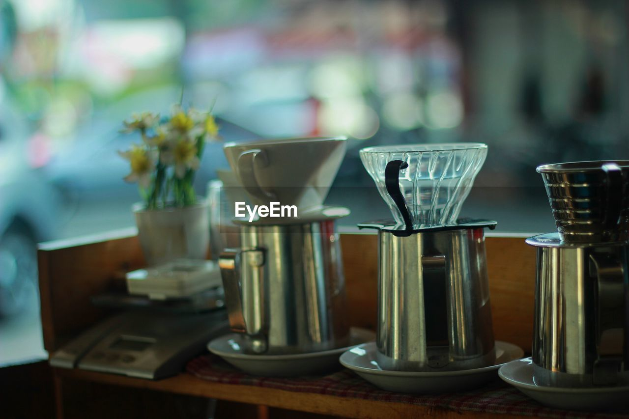 table, food and drink, close-up, still life, indoors, focus on foreground, freshness, no people, transparent, glass - material, container, food, household equipment, side by side, drink, vase, variation, refreshment, glass, choice