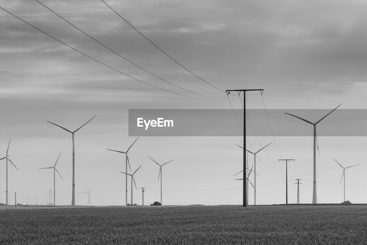 fuel and power generation, environment, wind turbine, turbine, sky, renewable energy, alternative energy, environmental conservation, field, wind power, land, cloud - sky, landscape, technology, nature, electricity, rural scene, power supply, beauty in nature, no people, outdoors, sustainable resources
