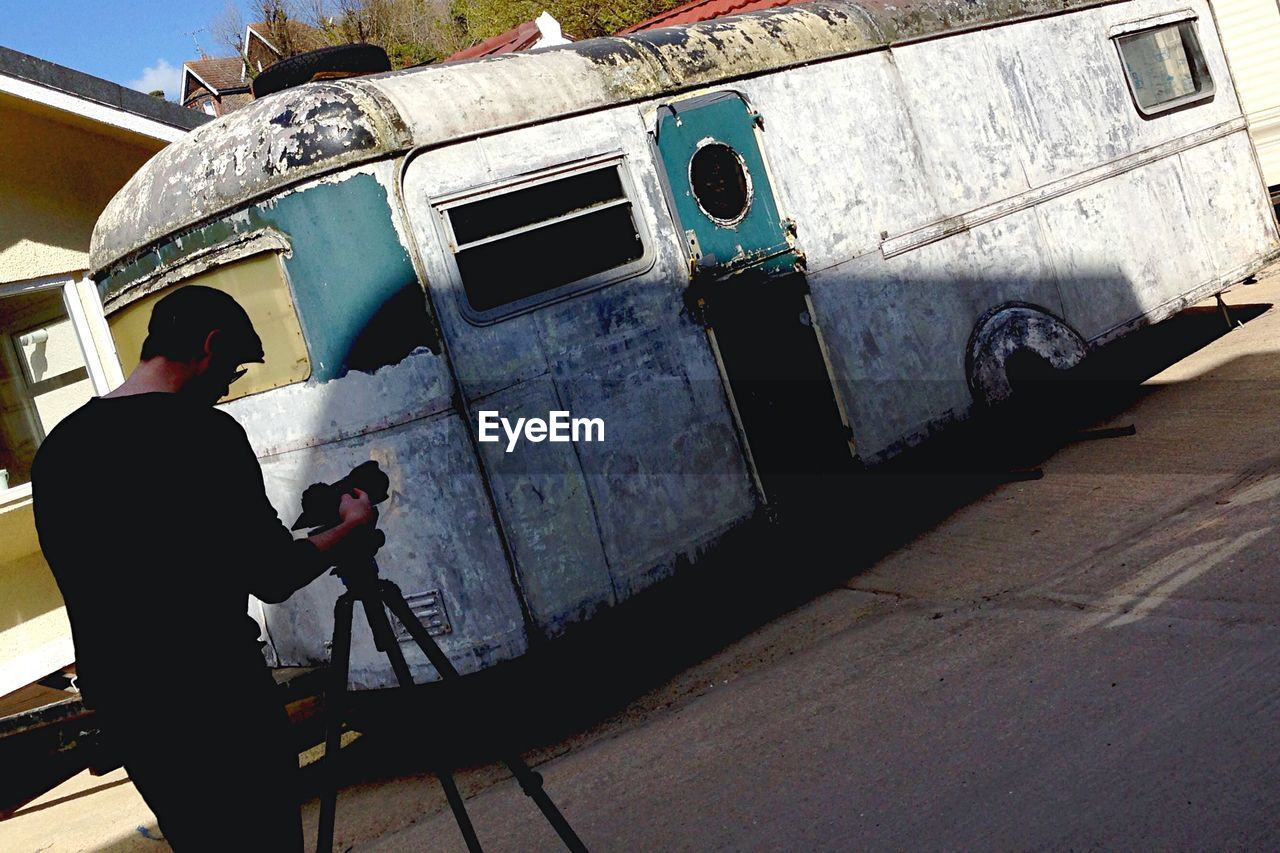 Man photographing old bus