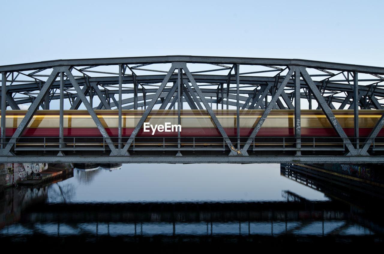 Scenic View Of Railroad Bridge Against Clear Sky