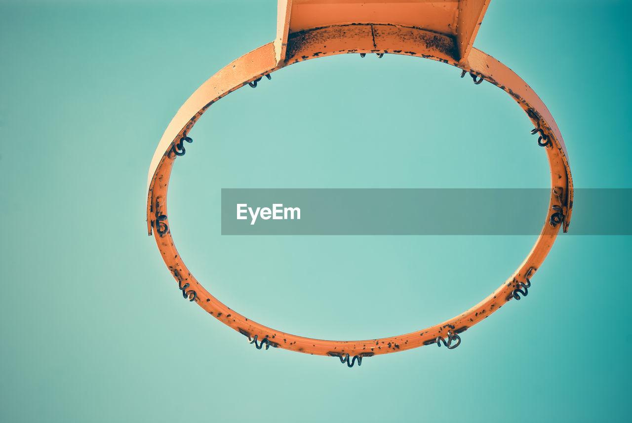 Directly Below Shot Of Old Basket Ball Hoop Against Blue Sky