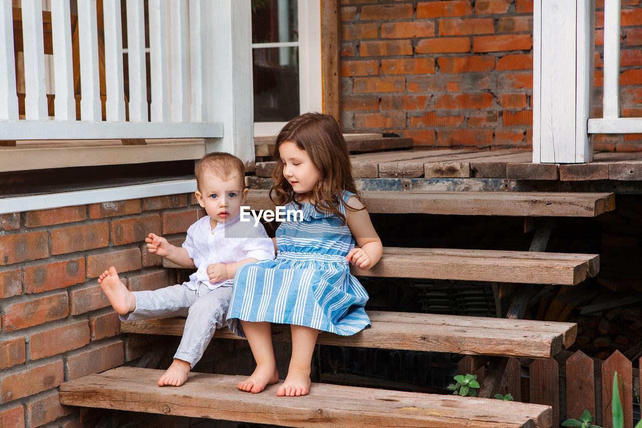 HAPPY GIRL SITTING ON BENCH