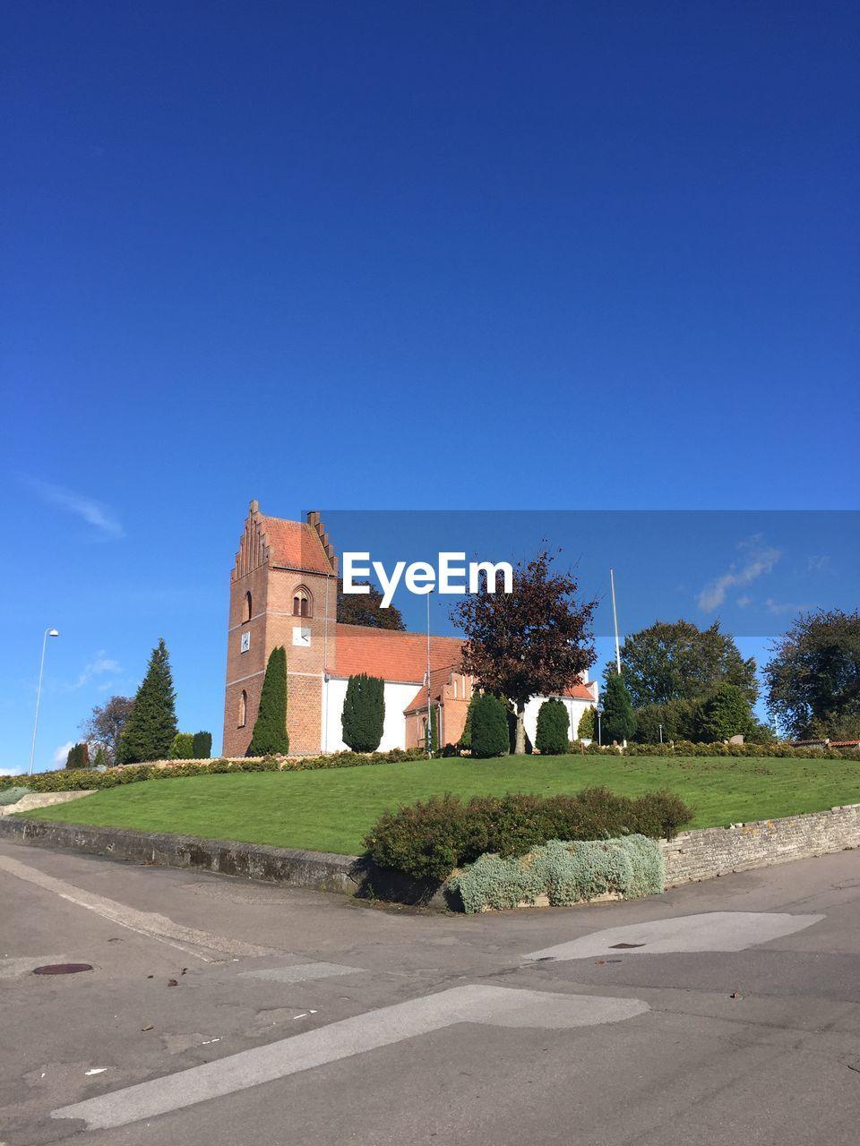 VIEW OF CASTLE AGAINST BLUE SKY