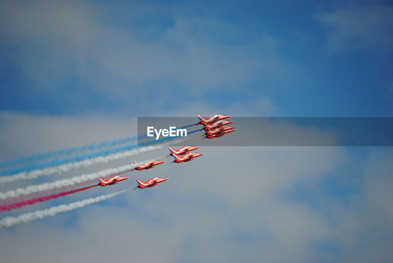 Low Angle View Of Fighter Planes Flying Against Sky During Airshow