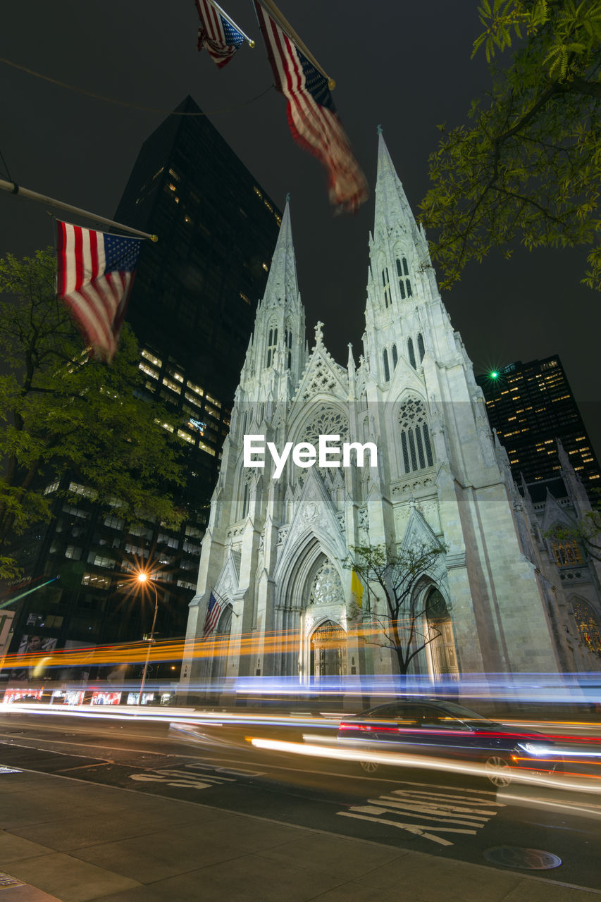 Light trail on street against st patrick cathedral in manhattan at night