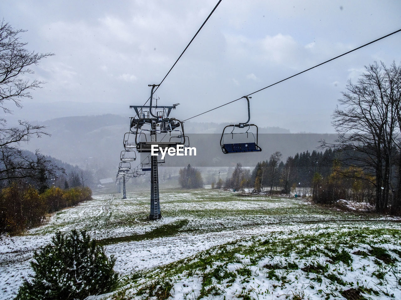 winter, cold temperature, snow, weather, nature, beauty in nature, transportation, sky, day, scenics, tree, cable, cloud - sky, outdoors, tranquility, no people, landscape, overhead cable car, ski lift, mountain