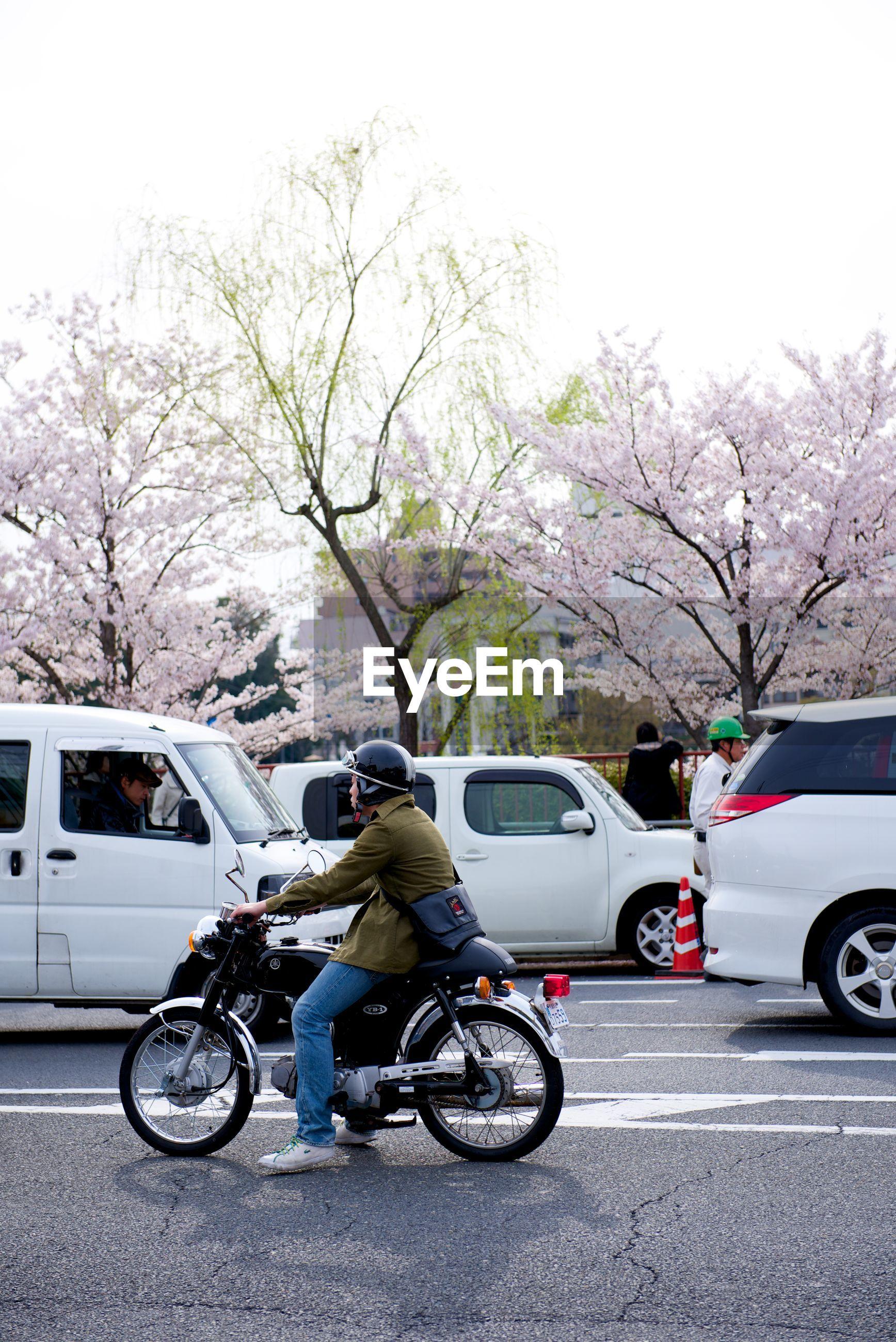 Man on motorbike on city street