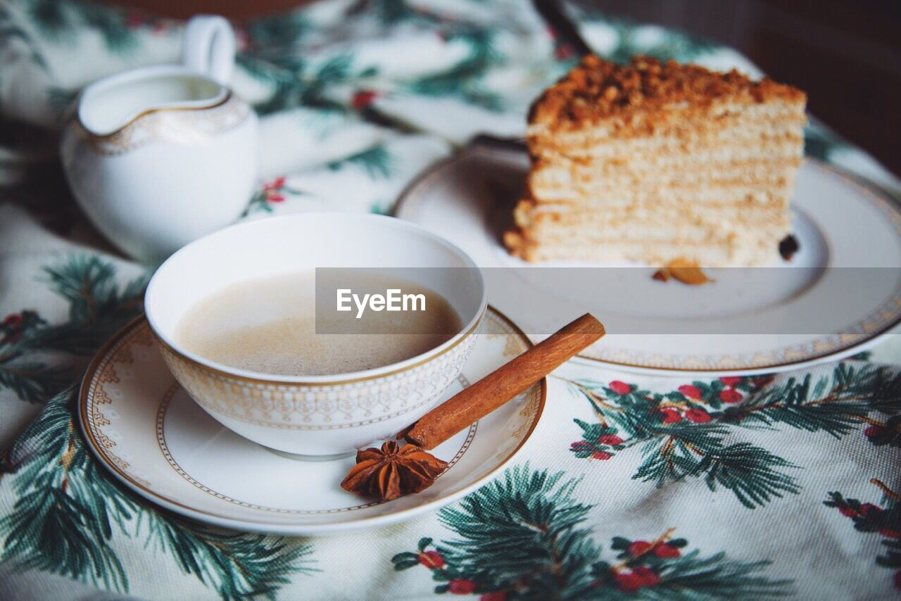 Close-Up Of Tea Cup And Cake