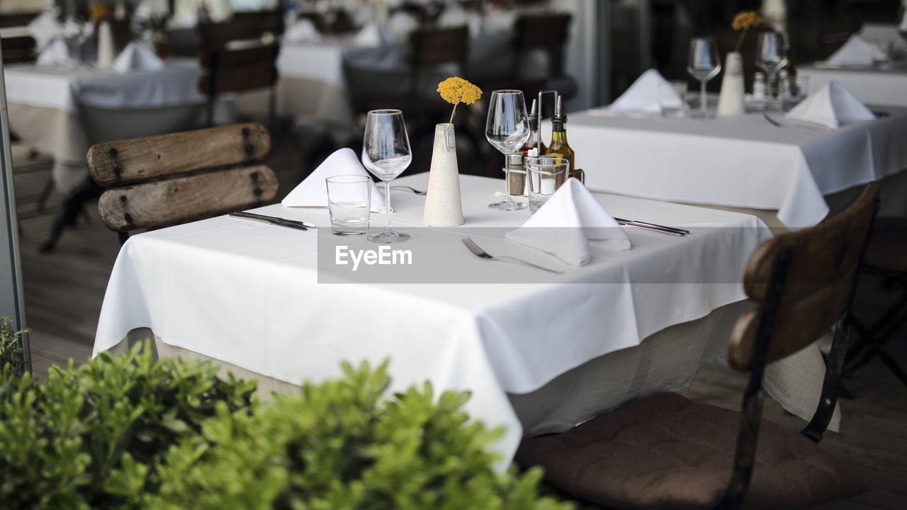 Table and chairs arranged in restaurant