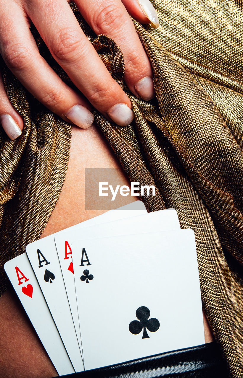 Cropped Image Of Woman Showing Playing Cards