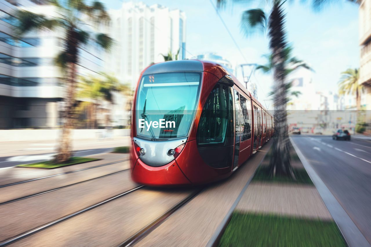 Blurred Motion Of Cable Car Moving In City