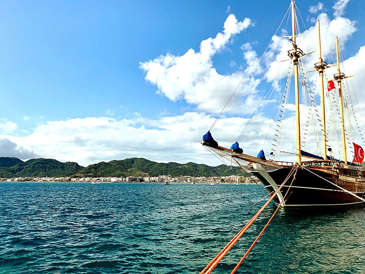 water, nautical vessel, sky, mode of transportation, transportation, cloud - sky, sea, nature, day, sailboat, beauty in nature, no people, scenics - nature, blue, waterfront, mountain, travel, sailing, mast, yacht