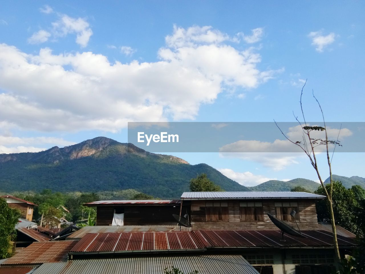 mountain, roof, sky, no people, architecture, day, nature, outdoors, tiled roof