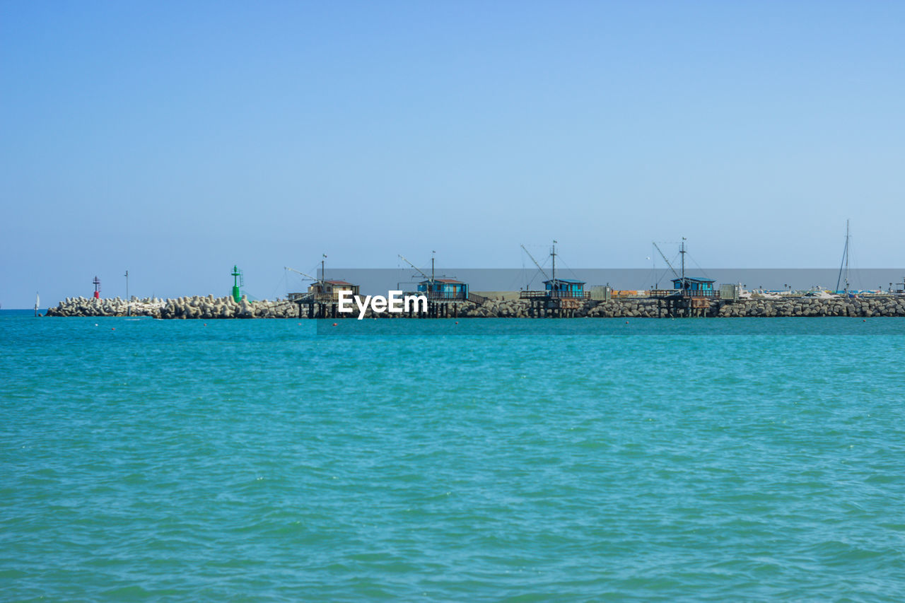 water, sea, sky, waterfront, copy space, scenics - nature, blue, clear sky, nature, beauty in nature, architecture, day, tranquility, no people, transportation, tranquil scene, outdoors, pier, idyllic, turquoise colored