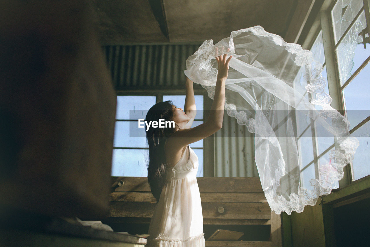 Woman Throwing Veil
