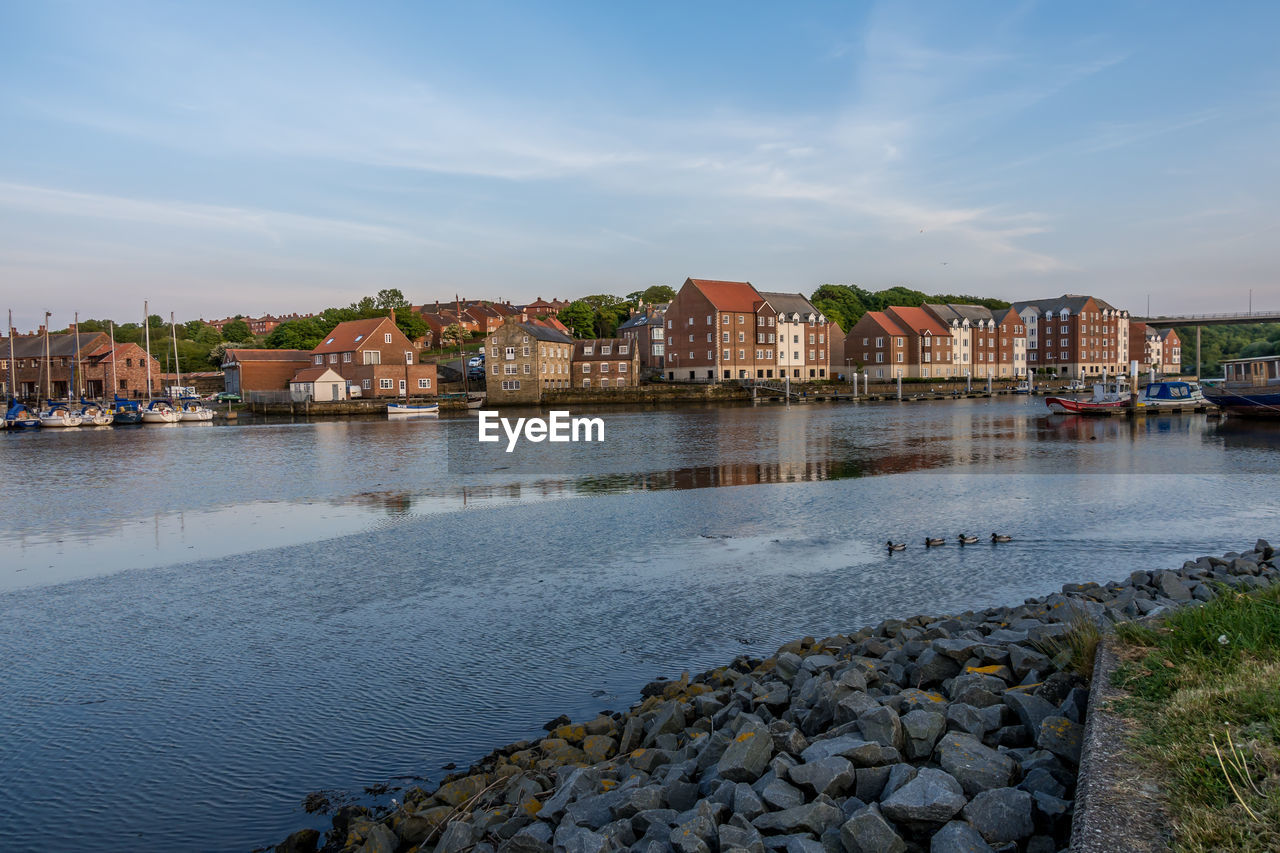 water, built structure, architecture, building exterior, sky, solid, rock, city, nature, building, cloud - sky, rock - object, no people, residential district, day, sea, outdoors, beauty in nature, townscape