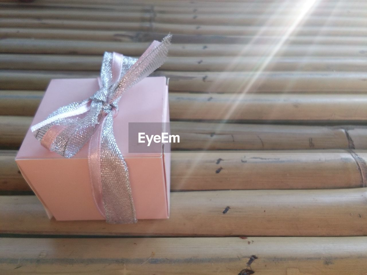 Close-Up Of Gift Box On Bamboos