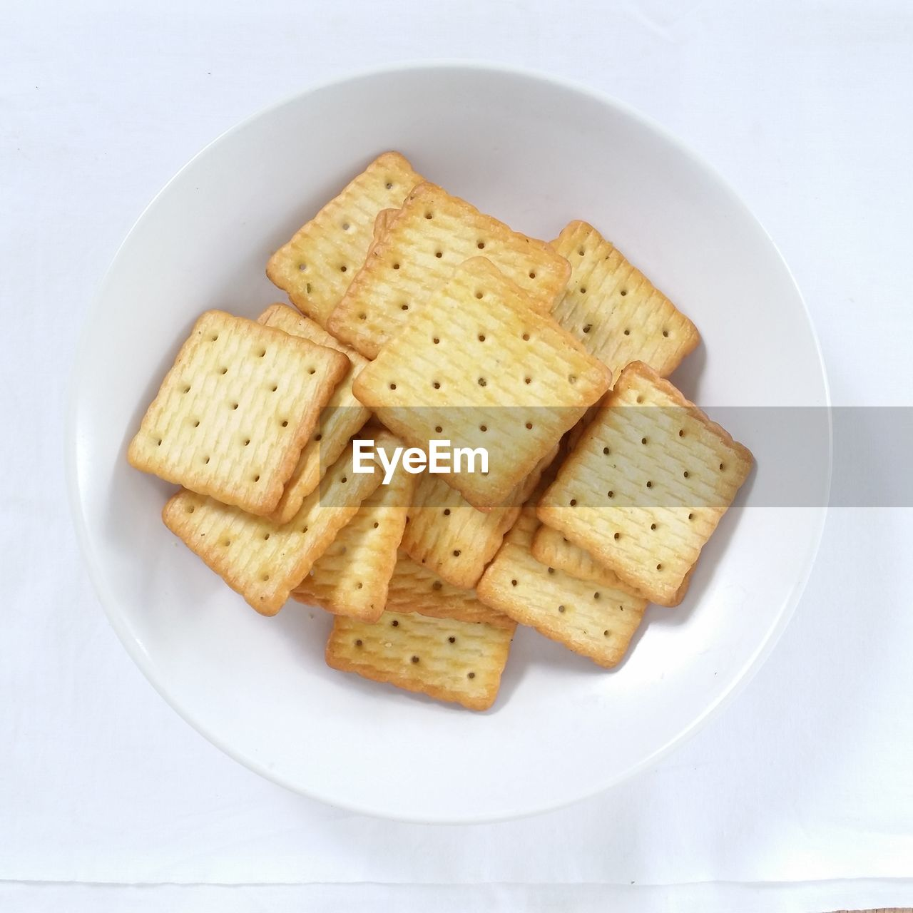 Directly above shot of crackers in bowl on table
