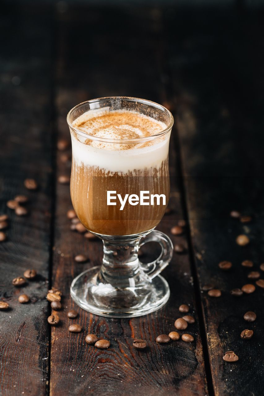 food and drink, drink, coffee - drink, coffee, refreshment, glass, wood - material, food, table, freshness, still life, no people, frothy drink, indoors, close-up, brown, drinking glass, hot drink, cappuccino, focus on foreground, latte, temptation, layered, caffeine