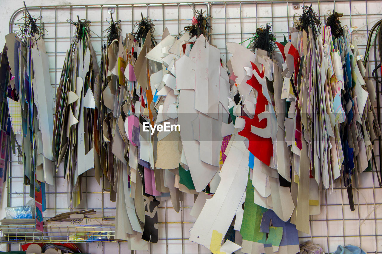 LOW ANGLE VIEW OF CLOTHES DRYING AGAINST WALL