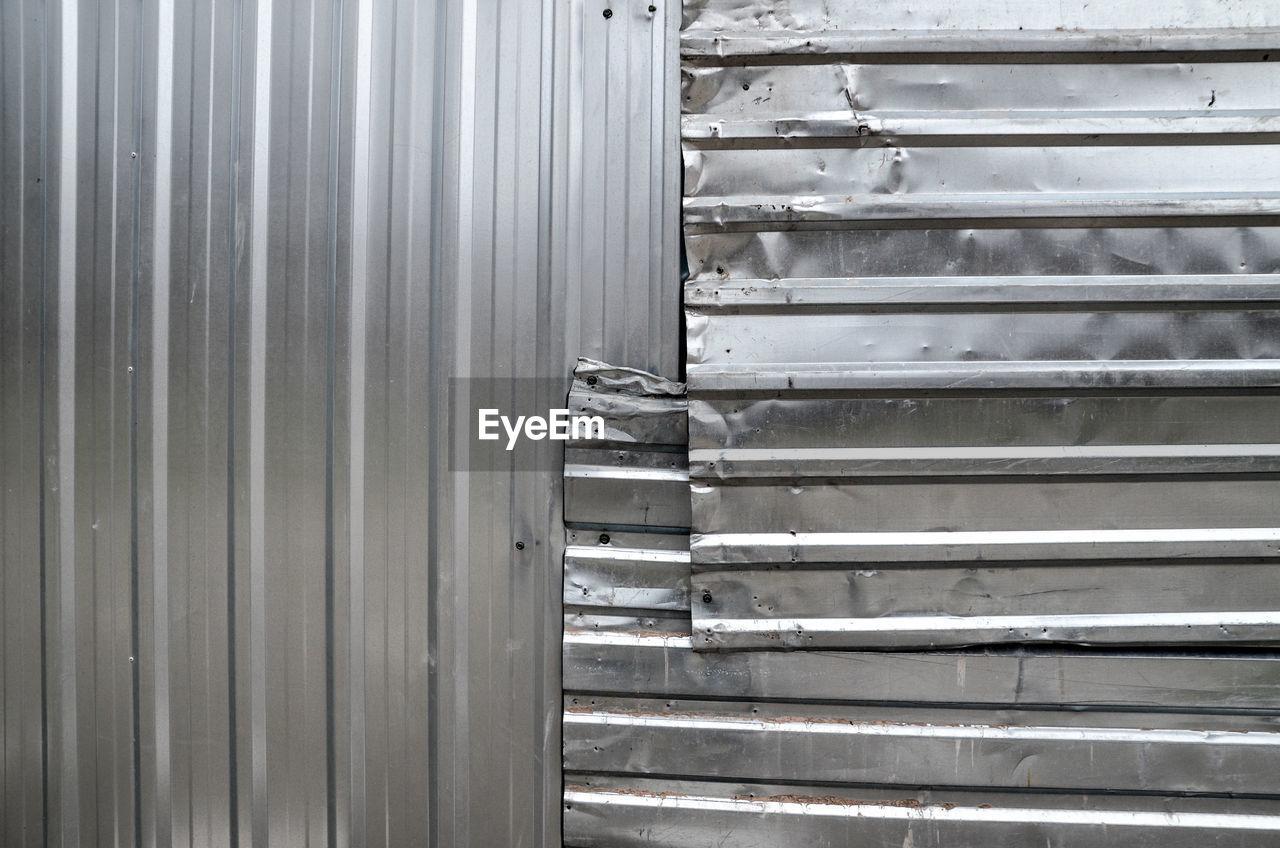 Full frame shot of silver metallic wall