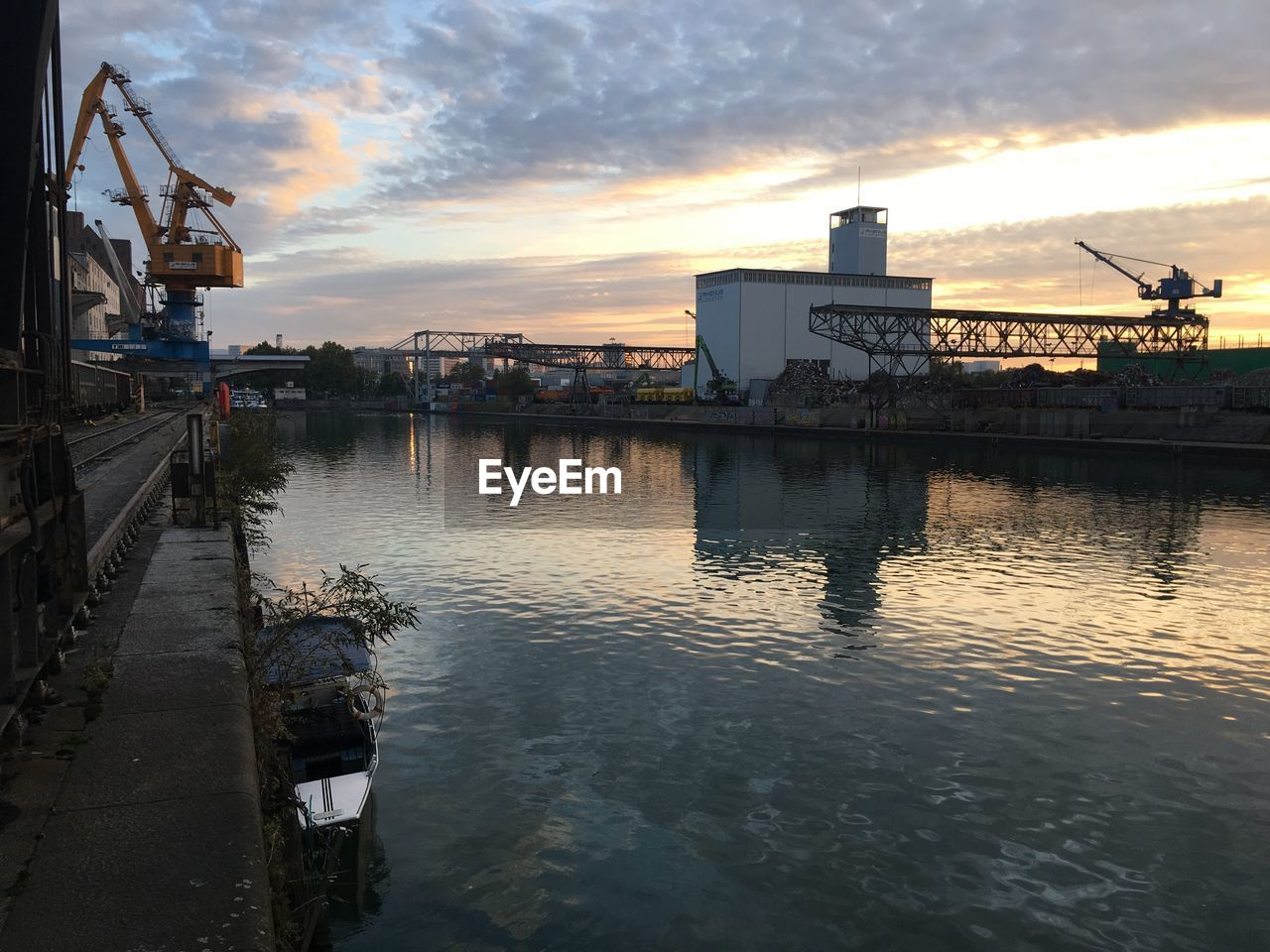 water, sky, cloud - sky, architecture, sunset, built structure, industry, nature, building exterior, transportation, reflection, nautical vessel, waterfront, freight transportation, city, no people, mode of transportation, factory, commercial dock, outdoors