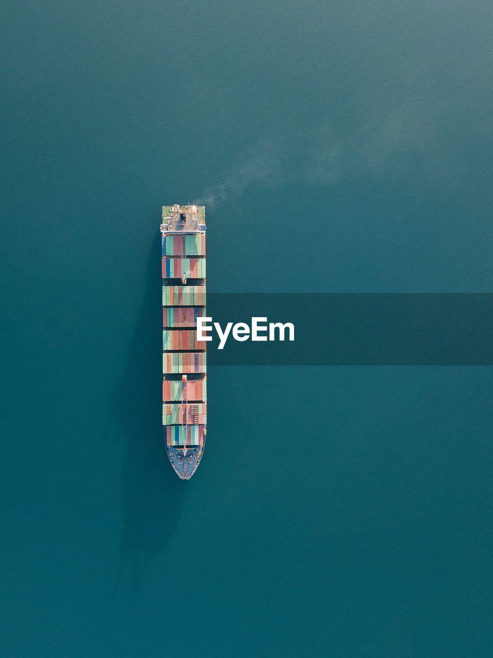 High Angle View Of Cargo Ship On Sea