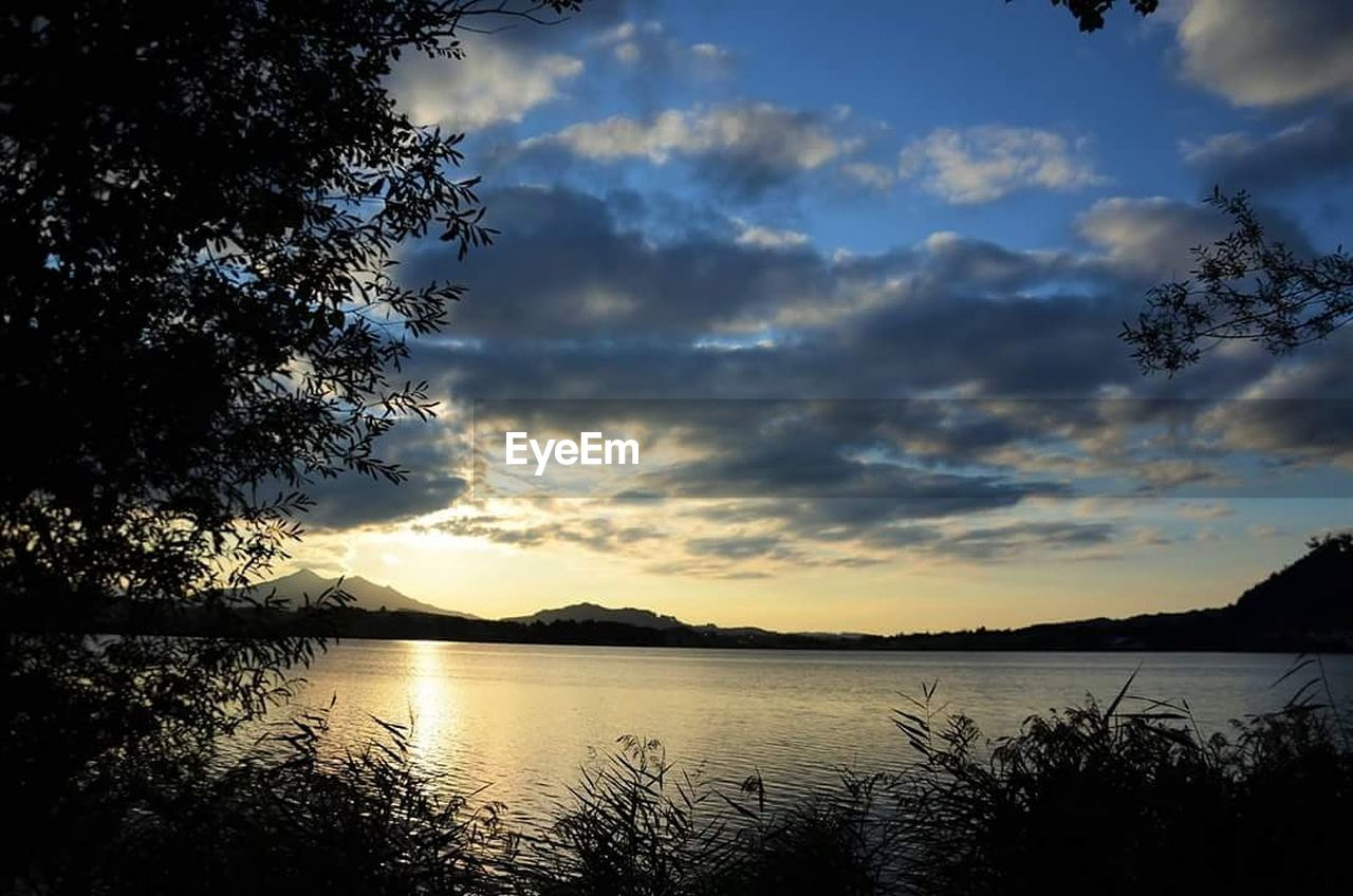 sky, lake, nature, water, reflection, beauty in nature, silhouette, sunset, scenics, tranquil scene, cloud - sky, tranquility, tree, no people, outdoors, mountain, day