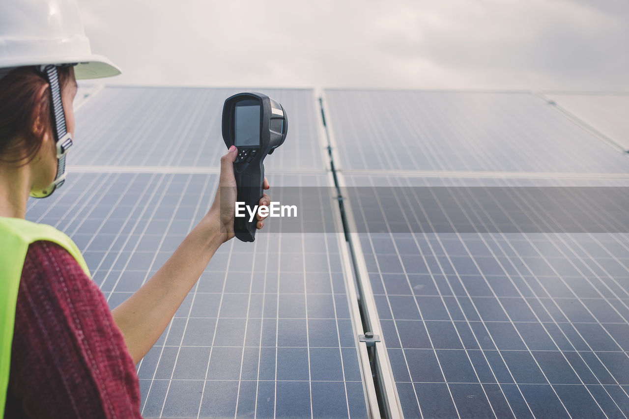 technology, alternative energy, renewable energy, solar panel, solar energy, environmental conservation, fuel and power generation, one person, occupation, environment, real people, sky, nature, men, adult, environmental issues, day, lifestyles, holding, sustainable resources, electricity, mature men, outdoors, power supply