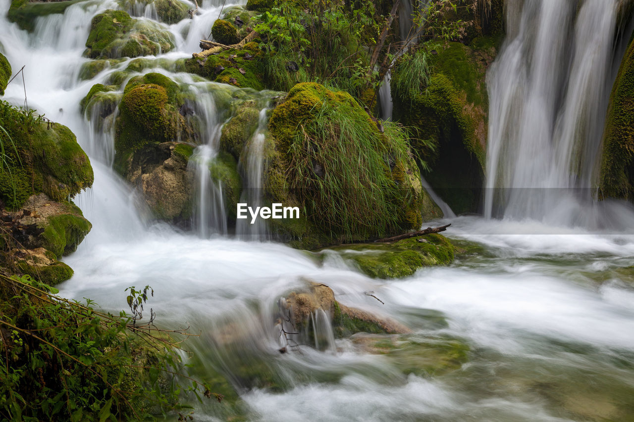 scenics - nature, water, waterfall, motion, long exposure, flowing water, beauty in nature, tree, plant, forest, rock, rock - object, blurred motion, solid, land, no people, nature, environment, moss, flowing, power in nature, outdoors, rainforest, falling water