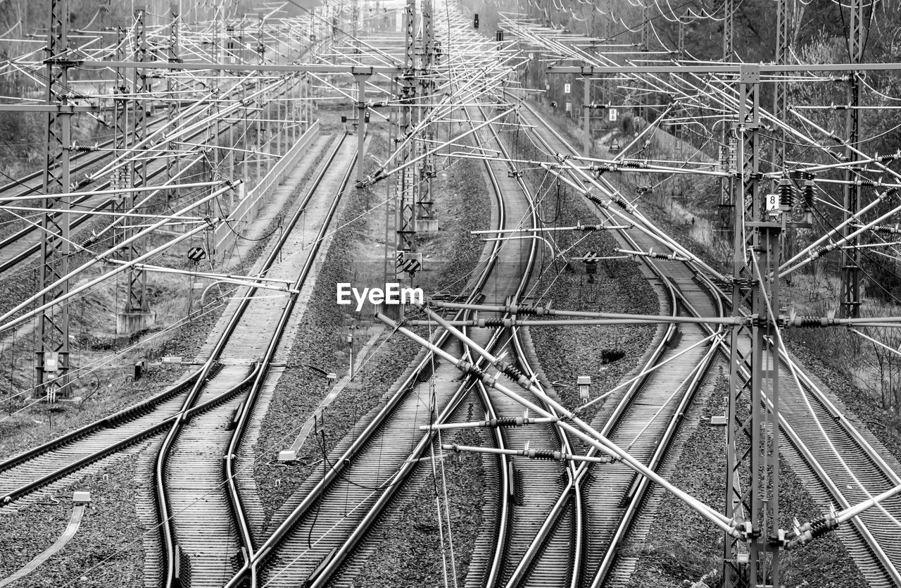 High angle view of electricity pylons over railroad tracks