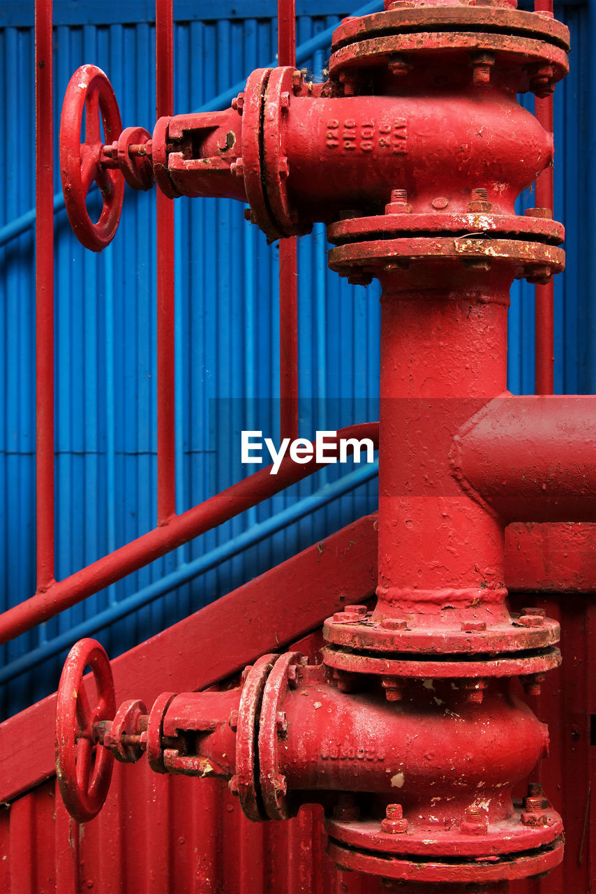 Red metallic pipe with valves