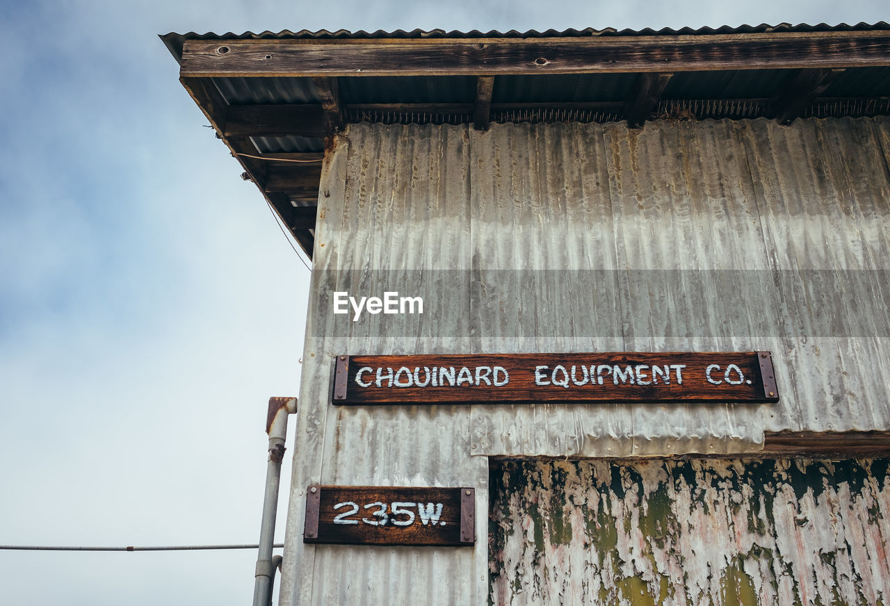 LOW ANGLE VIEW OF TEXT ON OLD BUILDING