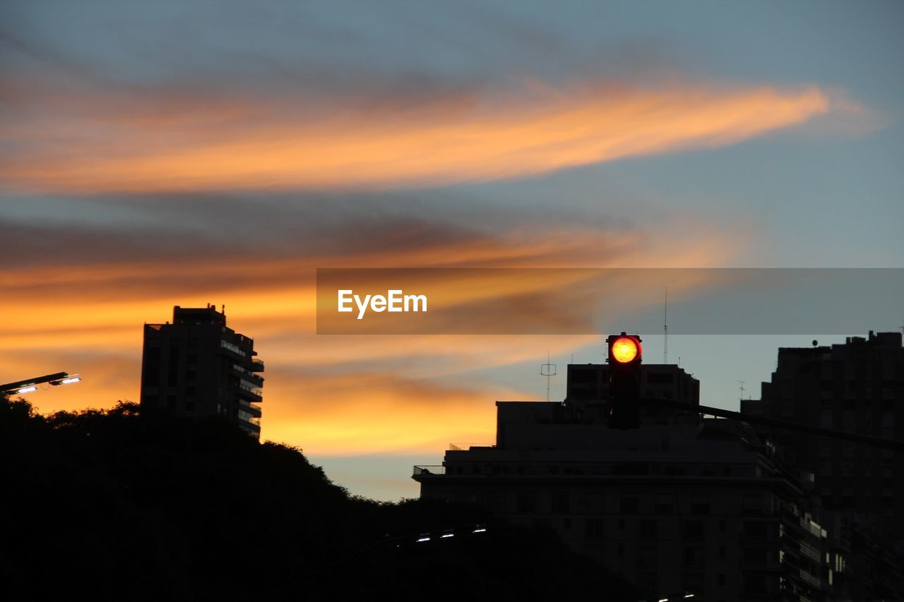 sunset, architecture, building exterior, built structure, orange color, silhouette, sky, cloud - sky, low angle view, city, no people, outdoors, nature, day